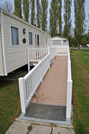Wheelchair ramp makes it easire to get in a holiday caravan